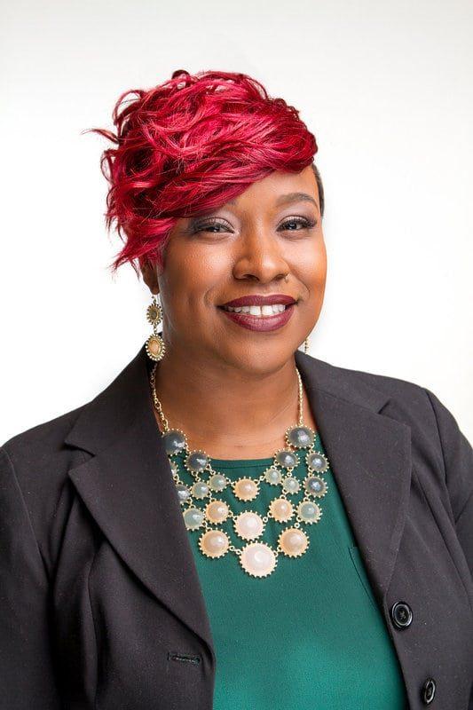 Iman Jose Black woman Business headshot