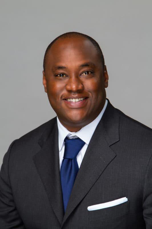 Black Business man Headshot Portrait on gray background